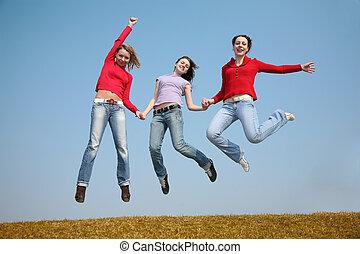 three jumping girls