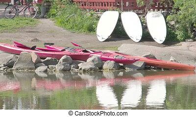 Three kayaks on the rocks FS700 Odyssey 7Q - Three kayaks on...