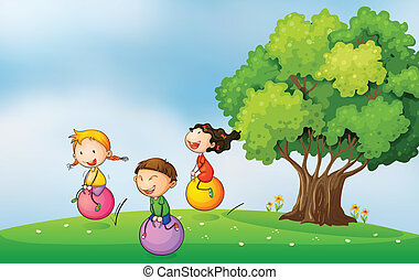 Three kids at the hilltop playing with the bouncing balls