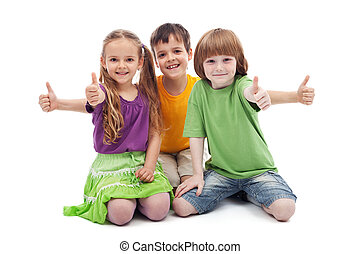 Three kids giving thumbs up sign - Group of three kids ...