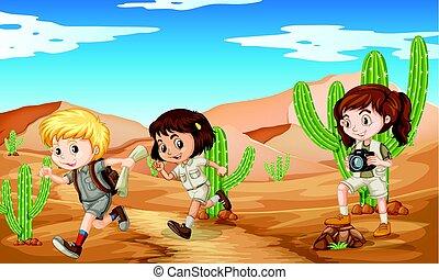 Three kids in safari outfit running in desert