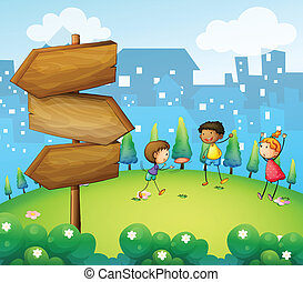 Three kids playing in the hill with wooden arrowboard