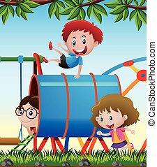 Three kids playing in the playground
