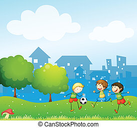 Three kids playing soccer in the hill