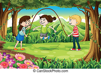 Three kids playing with a rope in the middle of the forest