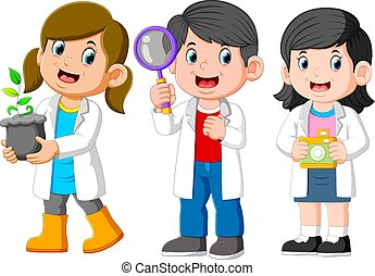 Three Kids Scientist Wearing White Laboratory Gown and Holding a Seedling, Magnifying Glass, Camera