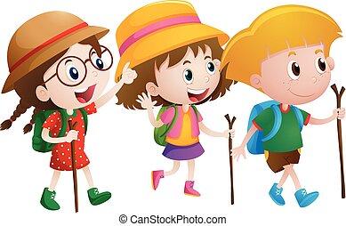 Three kids with walking sticks
