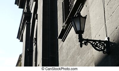 Three lamps of street lighting are fastened on the wall of...