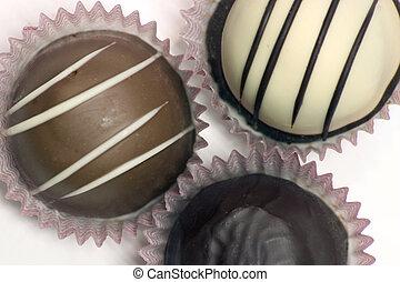 Three Large Truffles - Three different chocolate truffles on...