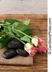 Three lava stones and three beautifull pink roses