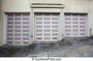 Three lavender garage doors