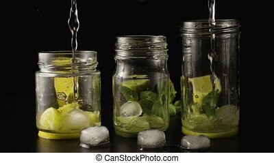 Three lemonade slow motion