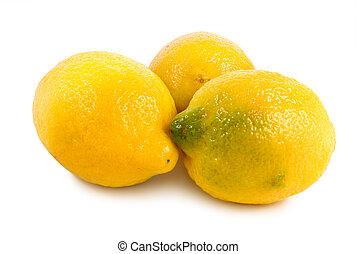 Three lemons isolated on a white
