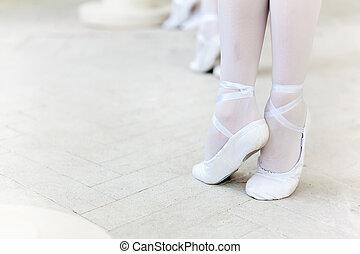 Three little ballerinas dancing. legs in ballet flats...