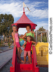 Three little girls at the playground