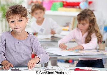 Three little girls in class