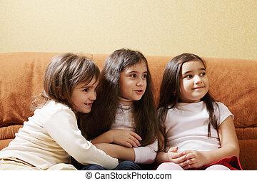 Three little girls on sofa