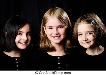 Three little girls posing