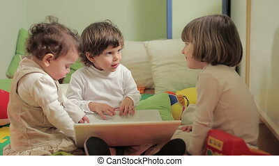 three little girls using laptop computer - multiple shots of...