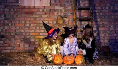 Three Little Halloween Witching Doing Magic With Pumpkins