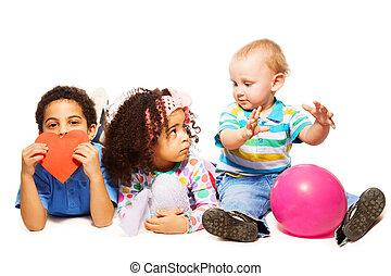 Three little kids playing