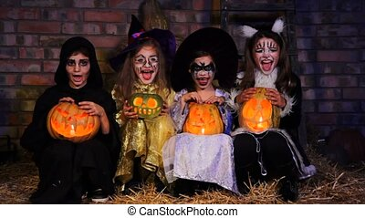 Three Little Witches and One Monster Screaming With Fear