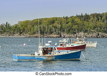 three lobster boats anchored in Bar Harbor Maine