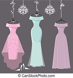 Three long bridesmaid dresses hang on ribbons - The...