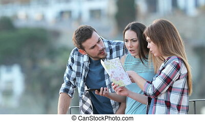 Three lost tourists arguing checking map - Three angry lost...