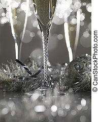 Three luxury champagne glasses on a grey bokeh background
