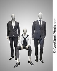 Three male mannequins dressed in suit