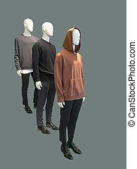 Three man mannequins dressed.
