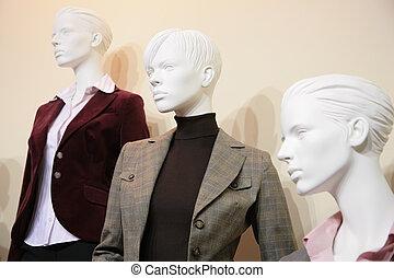 three mannequins in jackets