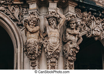 Three mans statue from Zwinger palace, Dresden, Germany