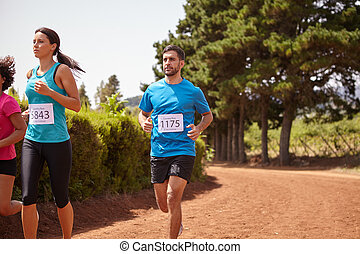 Three marathon runners in a race