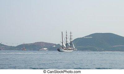Three mast yacht drifting in the Nha Trang bay, Vietnam....