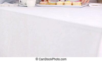 Three mature friends having cup cak