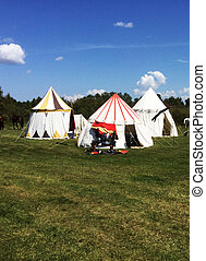 three Medieval tents Far - three white medieval tents