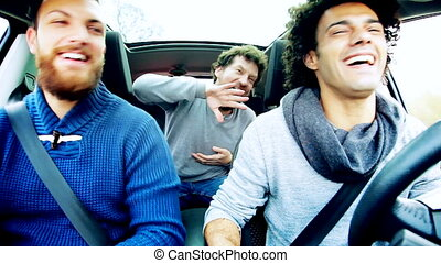 Three men dancing in car
