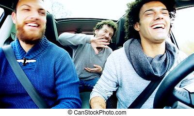 Three men dancing in car