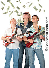 Three  men with two guitars look on falling dollars