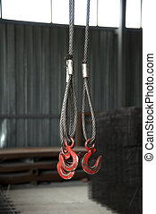 Three metal hooks with wire rope