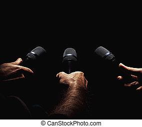 Three Microphones in Hands