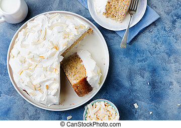 Three milk cake, tres leches cake with coconut. Traditional...