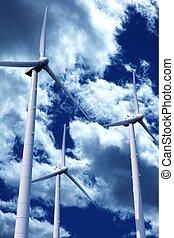 Wind Turbines - Three Modern Wind Turbines on Cloudy Blue...