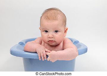 Three month old baby in a bathtub