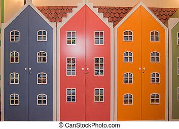 Three multi-colored children's wardrobe for toys in kindergarten or elementary school