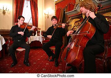 Three musicians, focus on right