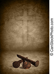 Three old rusty nails on grunge texture background with cross