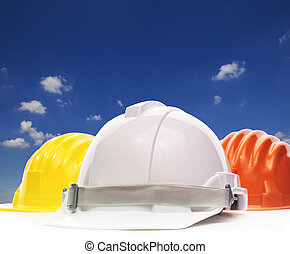 three of safety helmet construction protection on white against
